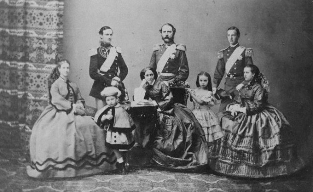 Christian IX of Denmark with his wife and their six children, 1862. Left to right: Dagmar, Frederick, Valdemar, Christian IX, Queen Louise, Thyra, George and Alexandra