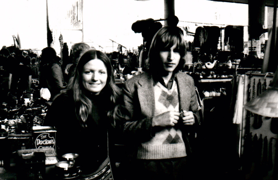 Olly and her then boyfriend (now husband) Nick, at their first stall under the Westway on the Portobello Road, early 1970s