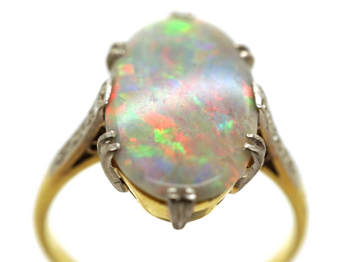 Harlequin opal engagement ring